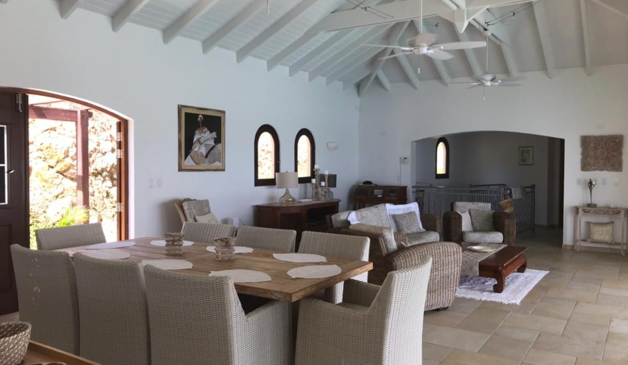 8.-for-sale-4-bedrooms-4.5-bath-villa-susan-fully-furnished-dawn-beach-st.-maarten-dining-with-living-rooom-shot